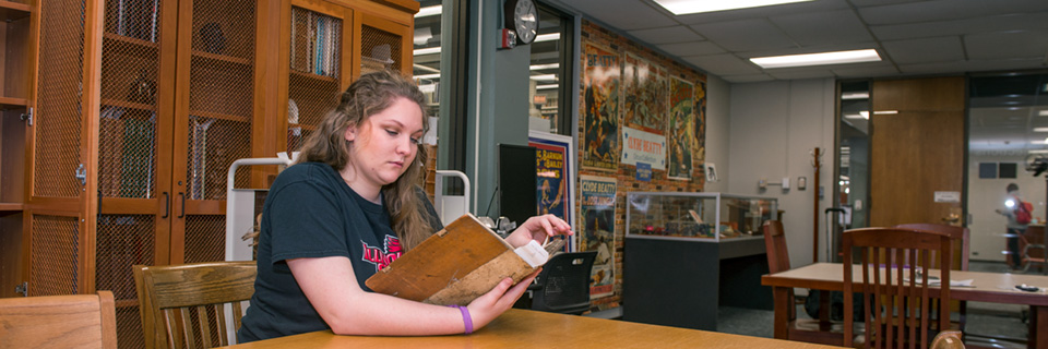Student checking out materials in a special collections