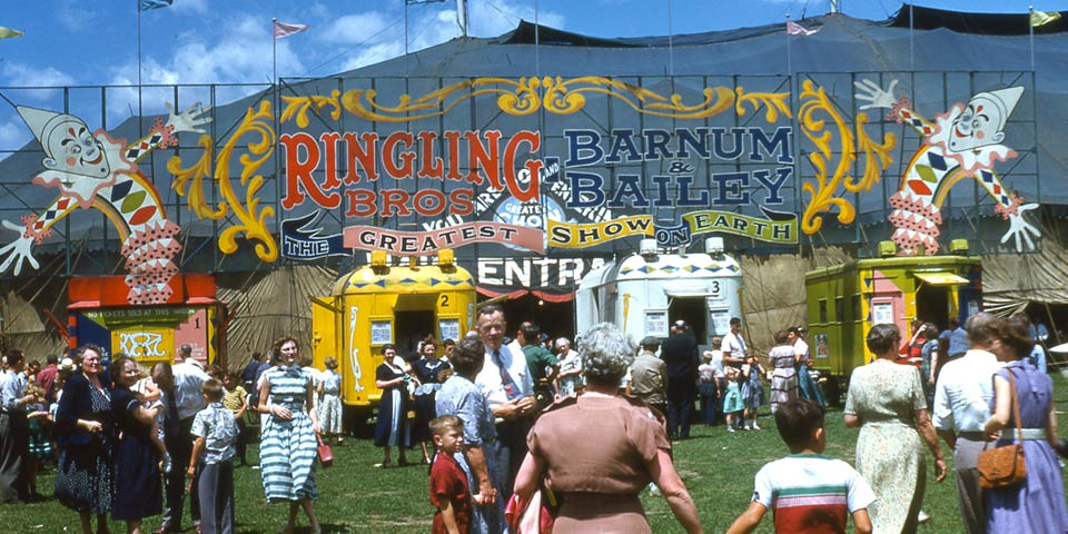 Ringling Barnum Circus, four ticket and office wagons and marquee or main entrance. July 7, 1953.