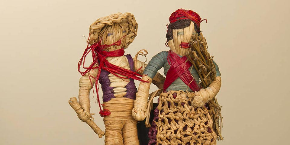 Two dolls stitched together, a man and a woman.