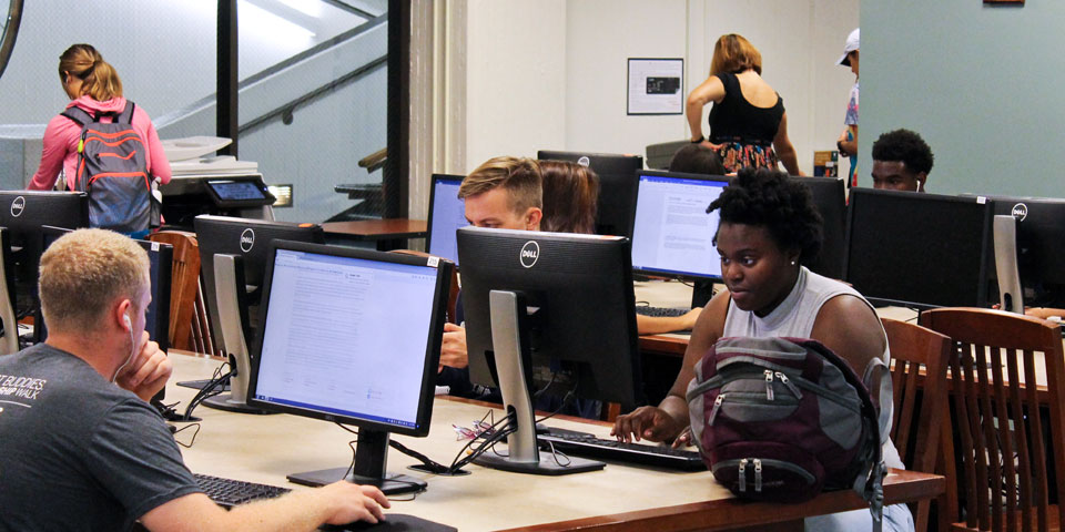 Students studying and working at Milner's workstations.